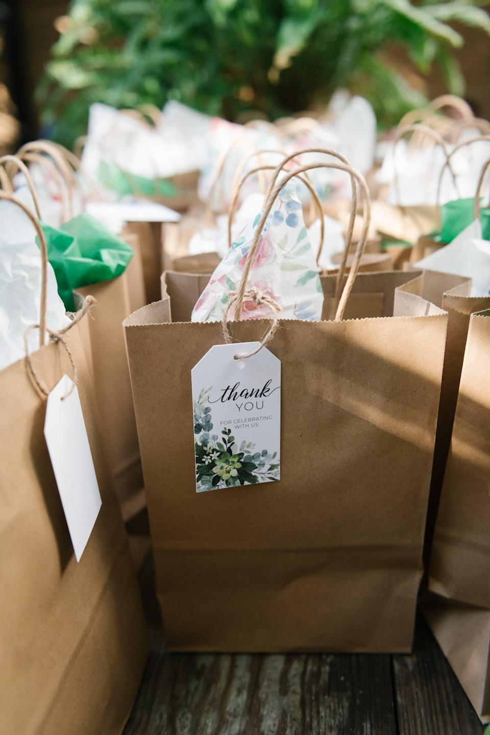 """<p>If you have personalized gifts for your guests, make <a class=""""link rapid-noclick-resp"""" href=""""https://www.popsugar.com/latest/DIY"""" rel=""""nofollow noopener"""" target=""""_blank"""" data-ylk=""""slk:DIY"""">DIY</a> gift bags so you know which present belongs to which person. The easiest way to do this is by attaching homemade name cards to each bag. You can add string, confetti, tissue paper, and more if you want to take these to the next level.</p>"""