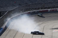 Carson Ware gets sideways as he comes out of Turn 4 in a NASCAR Xfinity Series auto race Saturday, Sept. 4, 2021, in Darlington, S.C. (AP Photo/John Amis)