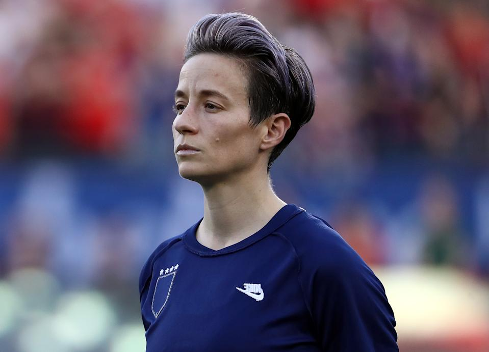 FRISCO, TEXAS - MARCH 11:  Megan Rapinoe #15 of the United States during the national anthem before the 2020 SheBelieves Cup match against Japan at Toyota Stadium on March 11, 2020 in Frisco, Texas. (Photo by Ronald Martinez/Getty Images)