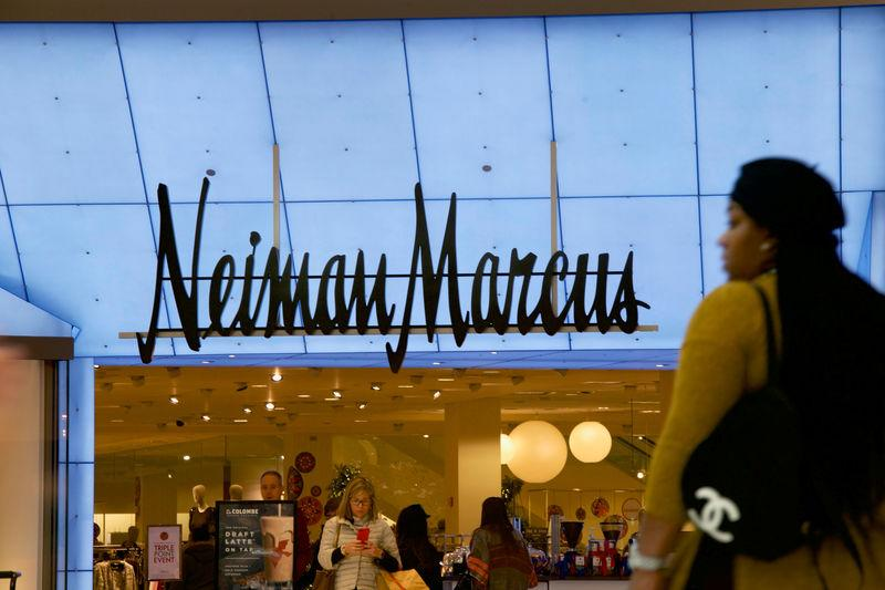 Shoppers enter and exit the Neiman Marcus at the King of Prussia Mall, United States' largest retail shopping space, in King of Prussia