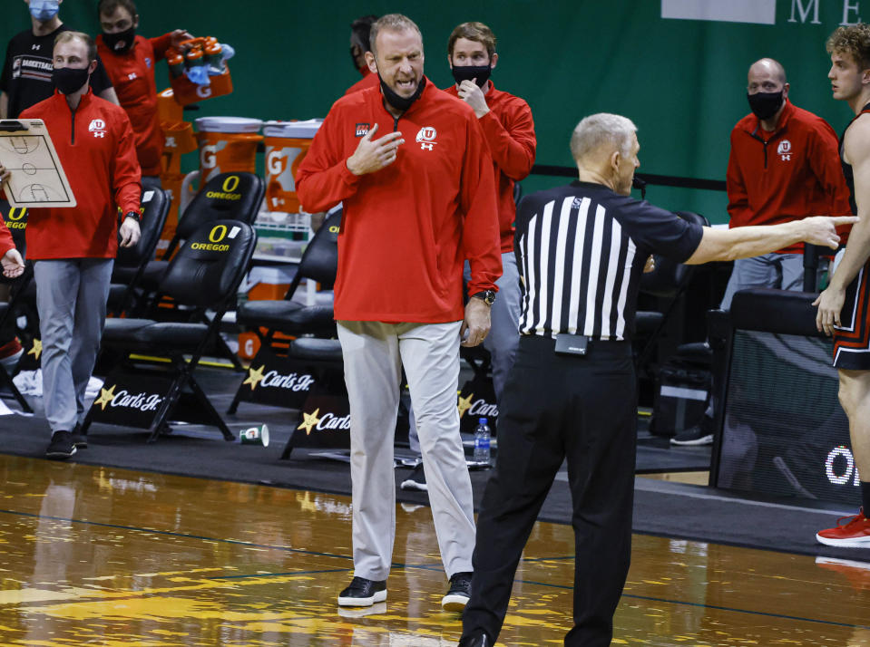 Utah coach Larry Krystkowiak questions an official about a call during the team's NCAA college basketball game against Oregon in Eugene, Ore., Saturday, Feb. 20, 2021. (AP Photo/Thomas Boyd)
