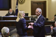 Prosecutor Tamara Strauch, left, speaks with defense attorney Raymond Fuchs during the capital murder trial of Otis McKane in the 2016 shooting death of San Antonio Police Detective Benjamin Marconi, Monday, July 26, 2021, in San Antonio. Jurors deliberated about 25 minutes Monday before convicting McKane. (Robin Jerstad/The San Antonio Express-News via AP)