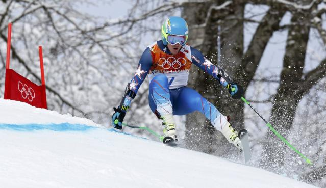 Ted Ligety of the U.S. skis during the first run of the men's alpine skiing giant slalom event at the 2014 Sochi Winter Olympics at the Rosa Khutor Alpine Center February 19, 2014. REUTERS/Stefano Rellandini (RUSSIA - Tags: SPORT SKIING OLYMPICS)