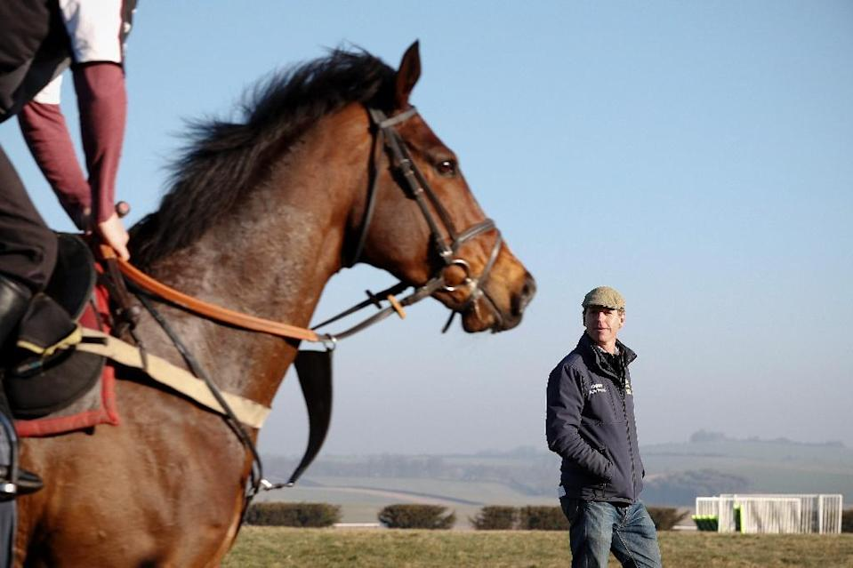 Trainer Jamie Snowden (R), who began with just one horse in a remote village in Wiltshire, says Cheltenham has an aura about it which no other meeting holds (AFP Photo/ADRIAN DENNIS)