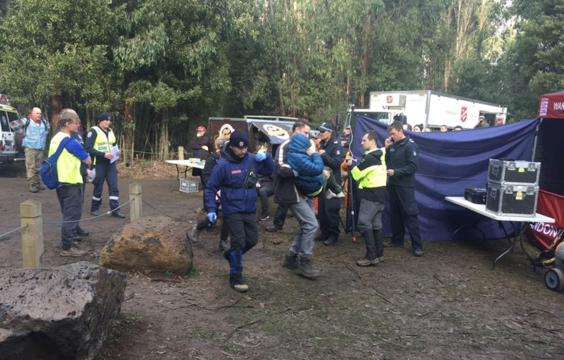 Will is shown being carried through the camp ground set up to search for him. Source: Twitter/VictoriaPolice