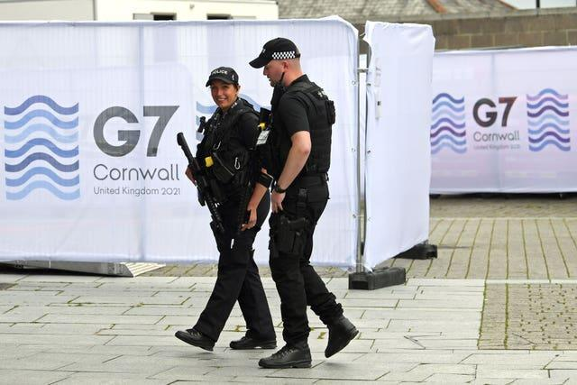 Police at the media centre in Falmouth, ahead of the G7 summit in Cornwall (Stefan Rousseau/PA)