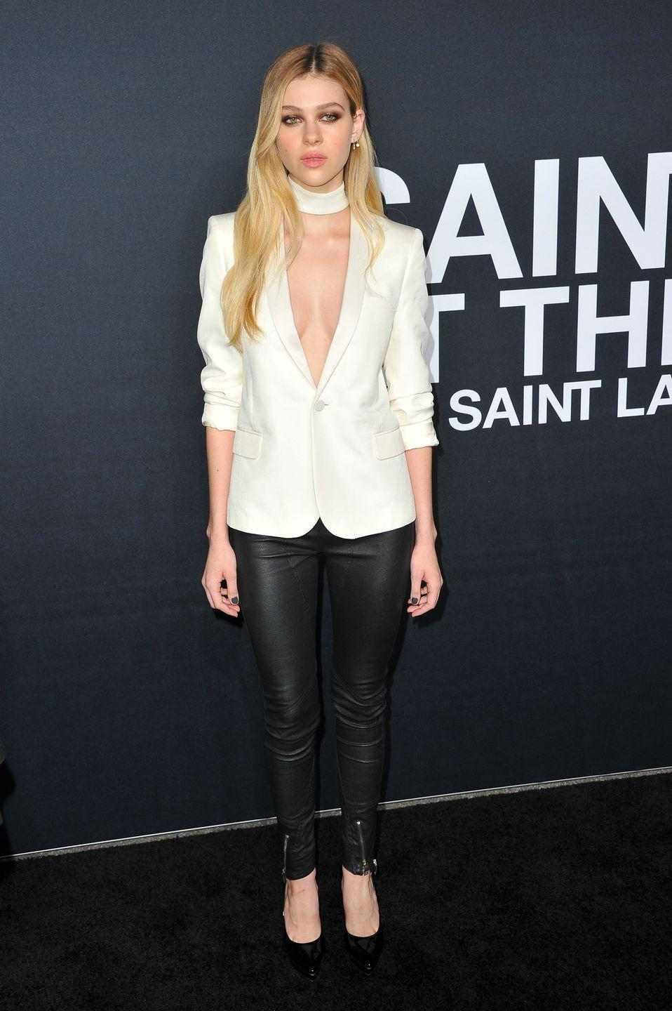<p>The star wore a white suit jacket, without a bra, and black leather trousers to the Hollywood Palladium in Los Angeles. </p>