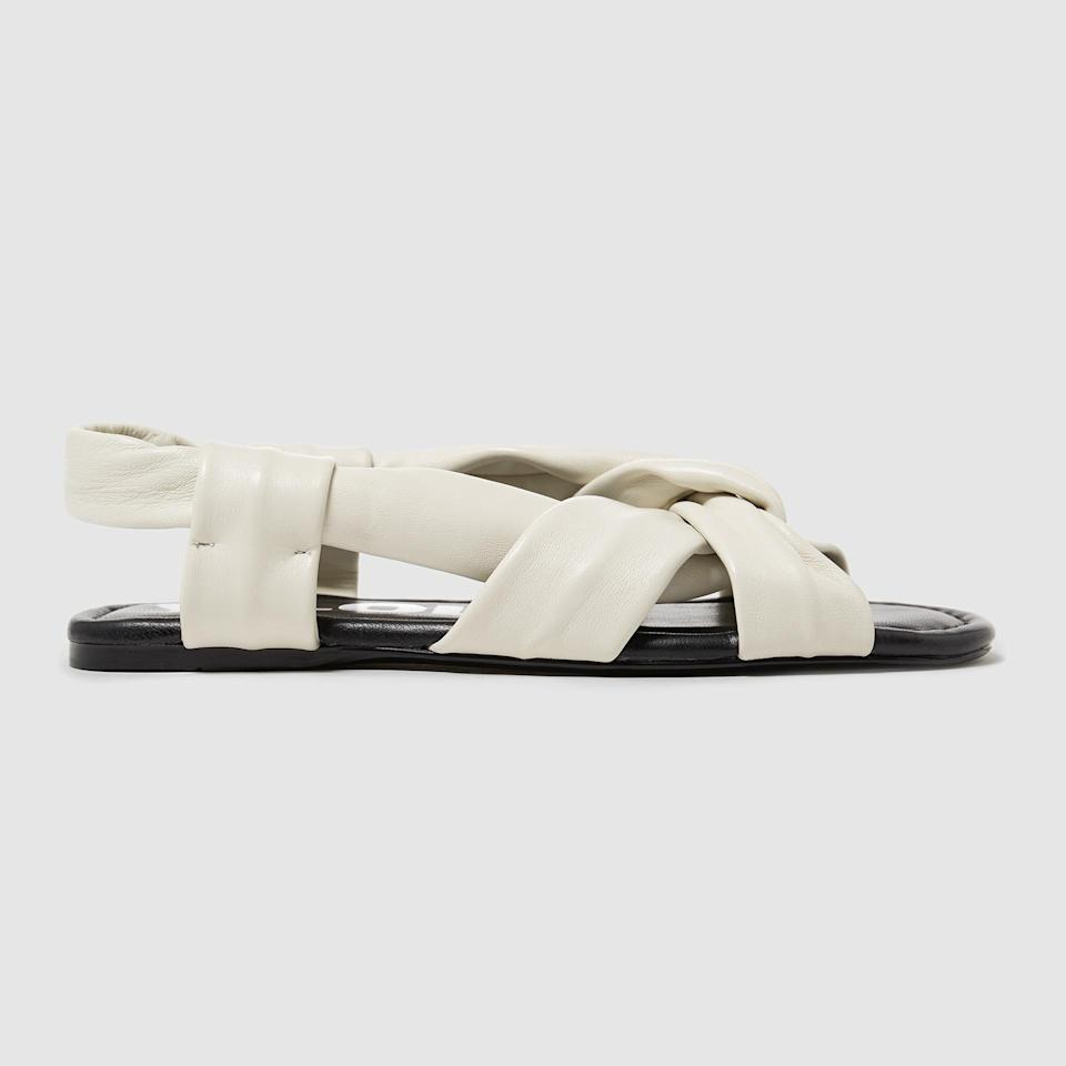 "<p><span>How chic would these cream-coloured wrap-style sandalss look with pale-wash, loose fitting jeans this summer? Answer: very chic. </span><br><em><a href=""https://www.bimbaylola.com/es_en/flat-white-leather-straps-sandals-181bz0730-t1060"" rel=""nofollow noopener"" target=""_blank"" data-ylk=""slk:Buy here."" class=""link rapid-noclick-resp""><span>Buy here.</span></a></em><br><br><br></p>"