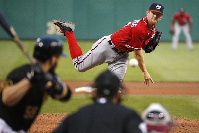 Washington Nationals starting pitcher Stephen Strasburg, top, delivers a pitch to Pittsburgh Pirates' Russell Martin (55) during the fourth inning of a baseball game in Pittsburgh, Saturday, May 24, 2014. (AP Photo/Gene J. Puskar)