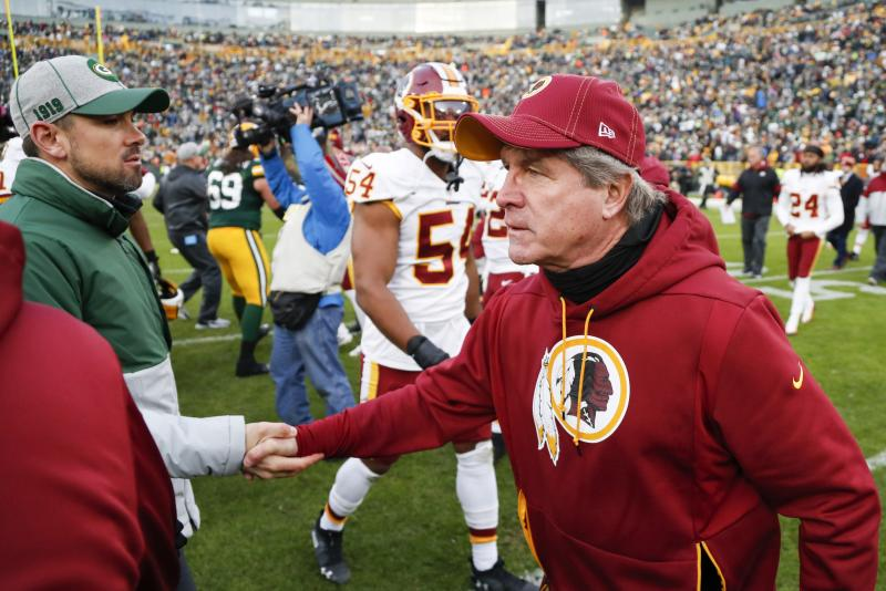 Washington Redskins head coach Bill Callahan shakes hands with Green Bay Packers head coach Matt LaFleur after an NFL football game Sunday, Dec. 8, 2019, in Green Bay, Wis. The Packers won 20-15. (AP Photo/Matt Ludtke)