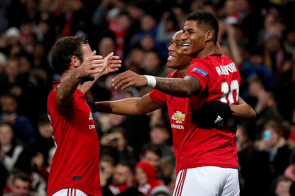 Manchester United's Anthony Martial (centre) celebrates scoring his side's second goal of the game with Juan Mata (left) and Marcus Rashford during the UEFA Europa League Group L match at Old Trafford, Manchester. (Photo by Martin Rickett/PA Images via Getty Images)