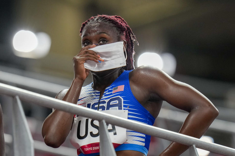 Lynna Irby of the United States wipes a tear away after the 4 x 400-meter mixed relay at the 2020 Summer Olympics, Friday, July 30, 2021, in Tokyo. (AP Photo/Petr David Josek)