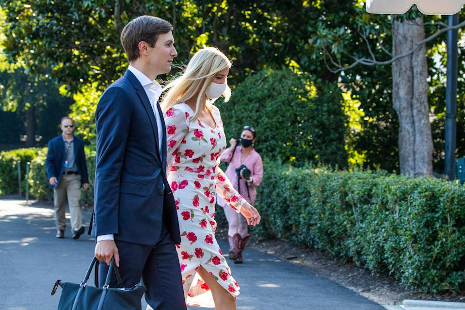 <p>Ivanka Trump, right, daughter of and adviser to President Donald Trump, and White House senior adviser Jared Kushner walk on the South Lawn after they arrived with the president at the White House, Sunday, July 26, 2020.</p> (AP)