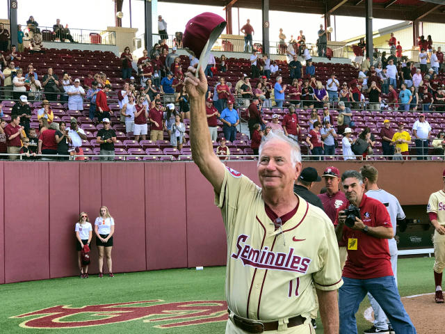 FILE - In this Feb. 19, 2017, file photo, Florida State coach Mike Martin salutes the crowd at Dick Howser Stadium in Tallahassee, Fla., after he got his 1,900th win when the Seminoles defeated VCU 11-3 in an NCAA college baseball game. Mike Martin has seen college baseball grow nationally in his 39 seasons as Florida States coach. His success leading the Seminoles though has remained a constant. Martin, who has 1,974 wins, needs three more to pass Augie Garrido for the most victories in NCAA baseball history. He could get the milestone this weekend when Florida State hosts Miami in a three-game series, April 27-29, 2018, in Tallahassee. (AP Photo/Joseph Reedy, File)