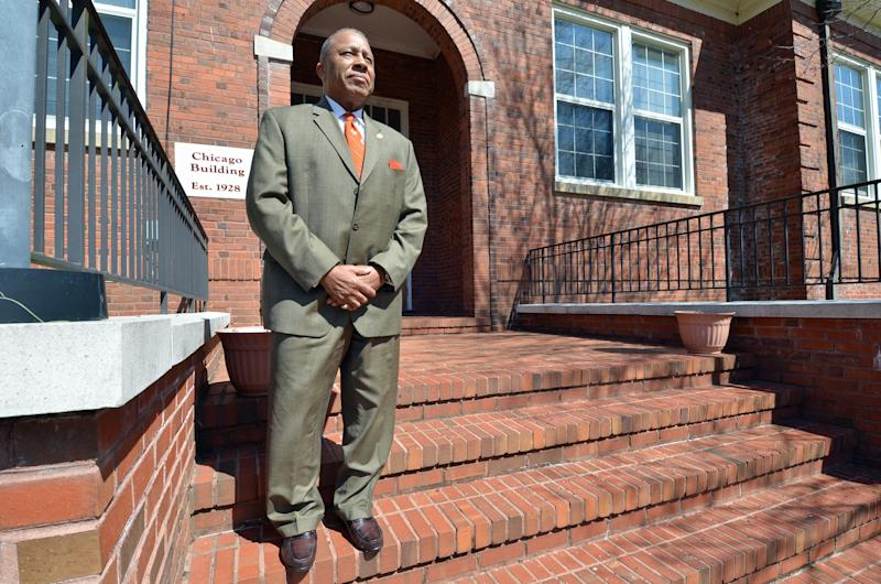 "St. Paul's College President Millard ""Pete"" Stith stands outside one of the 35 buildings for sale on the Lawrenceville, Va., campus of the historically black college and university on March 26, 2014. The college closed in 2013 under mounting debt and a loss of accreditation. Smith and St. Paul's alumni are hopeful an April 9 sale will resurrect the school, founded in 1888. (AP Photo/Courtesy of Mandana Marsh)"