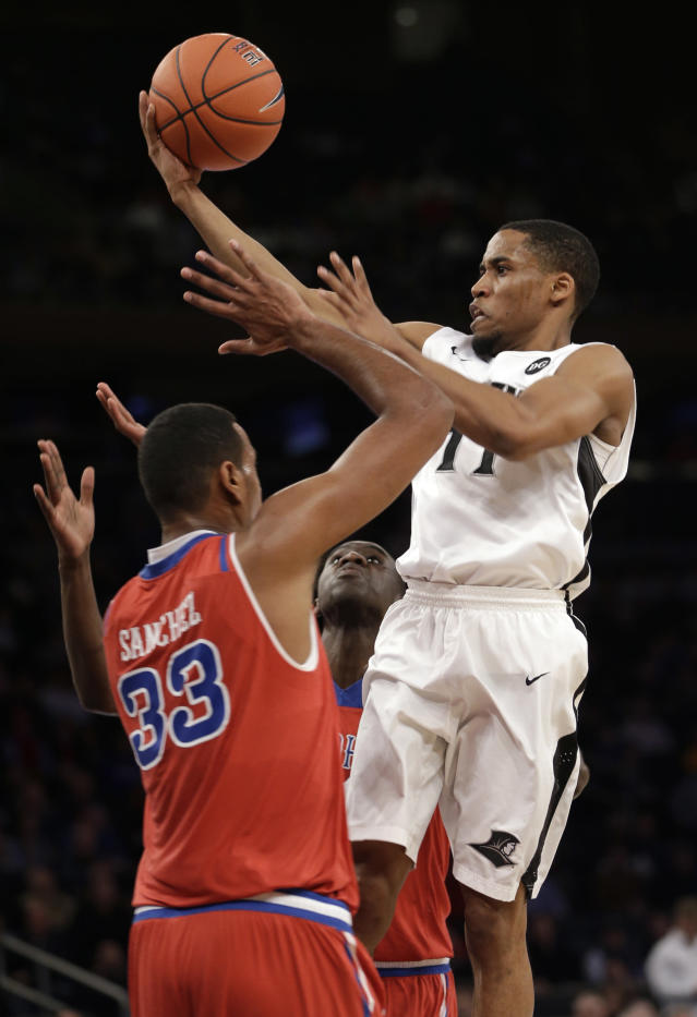 Providence's Bryce Cotton, right, drives to the basket over St. John's defenders during the first half of an NCAA college basketball game in the quaterfinals of of the Big East Conference tournament at Madison Square Garden, Thursday, March 13, 2014, in New York. (AP Photo/Seth Wenig)