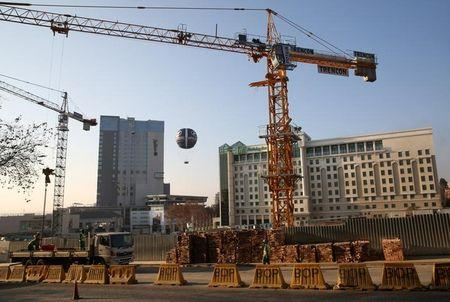 Cranes are seen at a construction site in Sandton outside Johannesburg