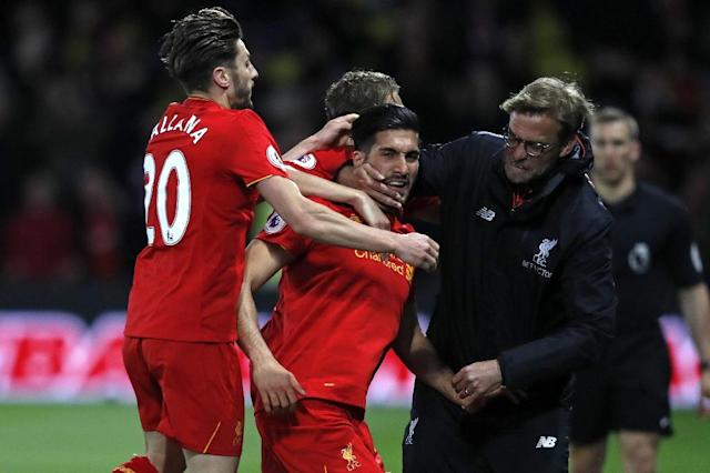 Liverpool's midfielder Emre Can (C) celebrates with Adam Lallana (L) and manager Jurgen Klopp after scoring against Watford on May 1, 2017 (AFP Photo/Adrian DENNIS)
