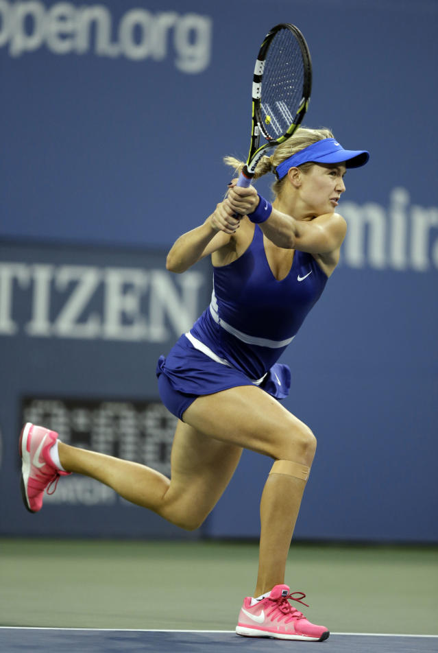 Eugenie Bouchard, of Canada, returns a shot to Barbora Zahlavova Strycova, of the Czech Republic, during the third round of the 2014 U.S. Open tennis tournament Saturday, Aug. 30, 2014, in New York. (AP Photo/Darron Cummings)