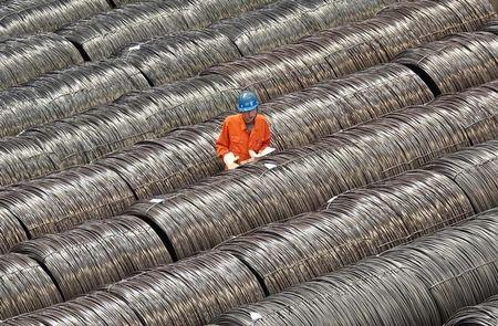 FILE PHOTO - A worker checks steel wires at a warehouse in Dalian, Liaoning province