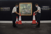 Embargoed until 13:30 BST Friday September 18 2020. Banksy's 'Show me the Monet' on display at Sotheby's in Central London, UK on September 18, 2020. Banksy's contemporary take on Claude Monet's depiction of the Japanese bridge in his garden at Giverny will be part of Sotheby's live-streamed auction on October 21, 2020. (Photo by Claire Doherty/Sipa USA)