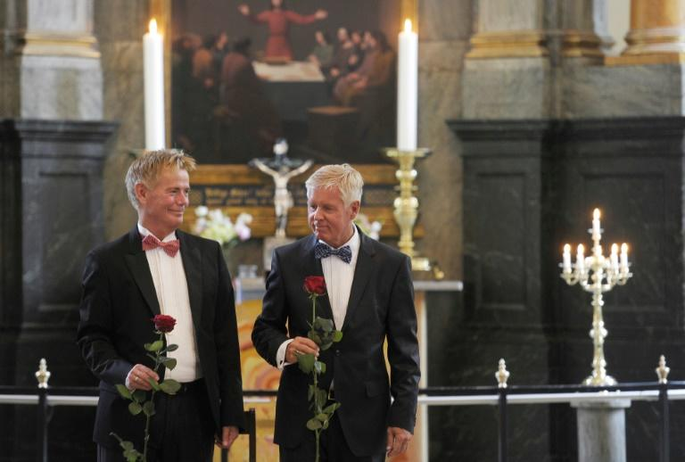 On October 1, 1989, for the first time in the world, gay couples in Denmark tied the knot in legal civil unions, but would have to wait until 2012 to be allowed to marry in church (AFP Photo/LISELOTTE SABROE)