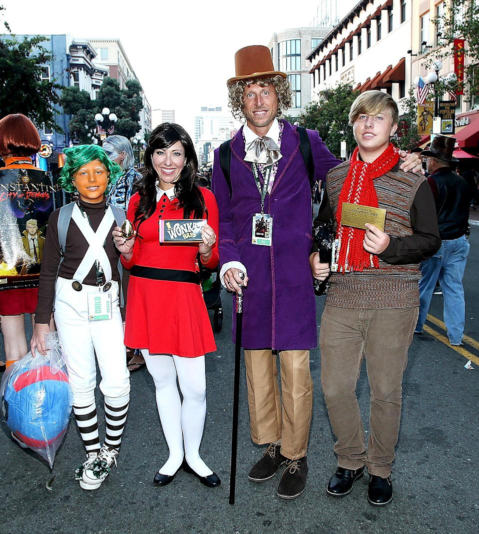<p>Cosplayers dressed an Oompa Loompa, Veruca Salt, Willy Wonka, and Augustus Gloop at Comic-Con International on July 20, 2018, in San Diego. (Photo: \Phillip Faraone/Getty Images) </p>