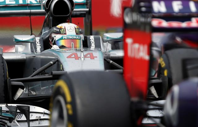 Mercedes driver Lewis Hamilton of Britain steers his car during the Hungarian Formula One Grand Prix in Budapest, Hungary, Sunday, July 27, 2014. Hamilton placed third in the race. (AP Photo/Darko Vojinovic)