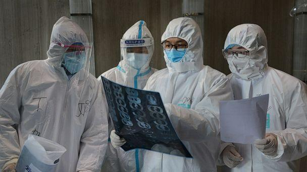 PHOTO: Medical workers in protective suits inspect a CT scan image at a hospital in Yunmeng county of Xiaogan city in Hubei, the province hit hardest by the novel coronavirus outbreak, China, Feb. 20, 2020. (China Daily/Reuters)
