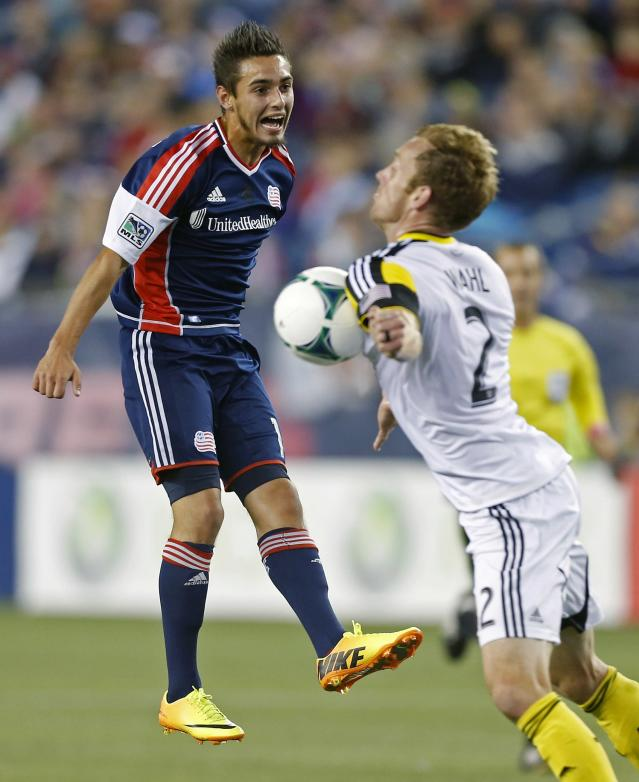 Columbus Crew's Tyson Wahl (2) stops the ball in front of New England Revolution's Diego Fagundez in the first half of an MLS soccer game in Foxborough, Mass., Saturday, Oct. 19, 2013. (AP Photo/Michael Dwyer)