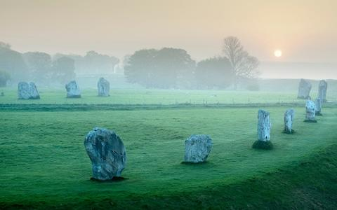 Ancient Stone Circle at Avebury, Wiltshire, England - Credit: Cultura/Craig Easton/Getty Images/Cultura RF