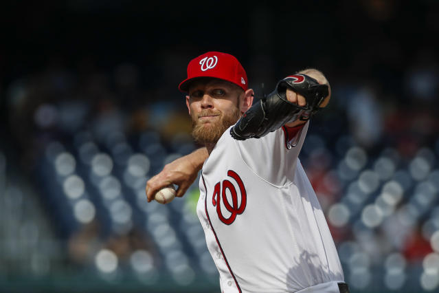 Washington Nationals starting pitcher Stephen Strasburg throws during the third inning of a baseball game against the Cincinnati Reds at Nationals Park, Wednesday, Aug. 14, 2019, in Washington. (AP Photo/Alex Brandon)