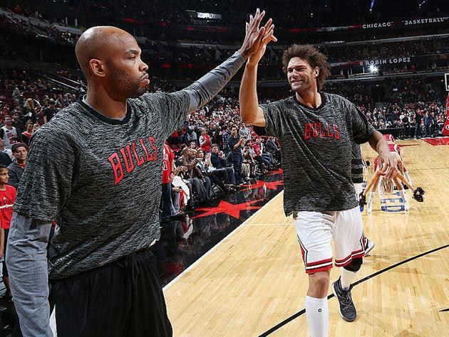 Taj Gibson and Robin Lopez line up. (Getty Images)