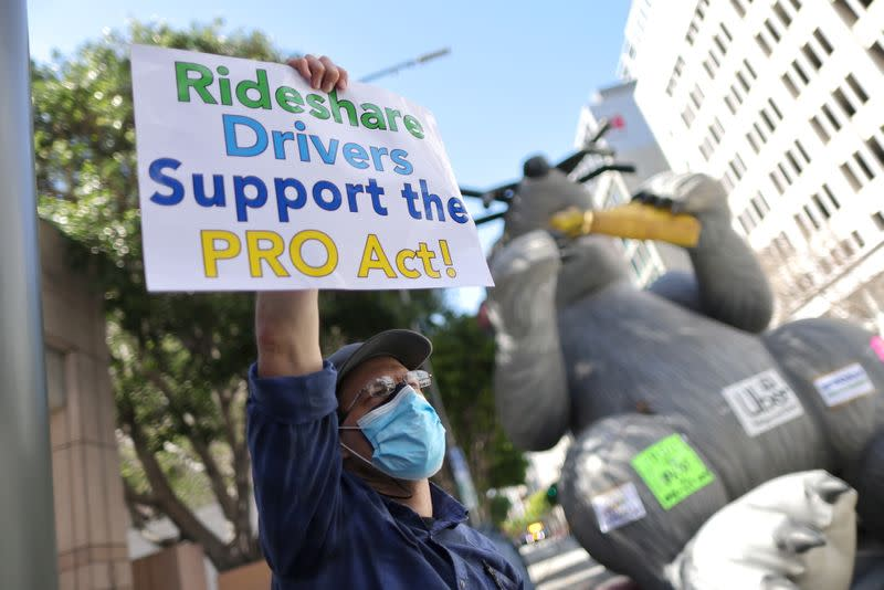 FILE PHOTO: Rideshare Uber and Lyft drivers rally in support of the PRO Act, in Los Angeles