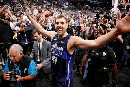 FILE PHOTO: Apr 10, 2019; San Antonio, TX, USA; Dallas Mavericks power forward Dirk Nowitzki (41) high fives the fans while leaving the court after the game against the San Antonio Spurs at AT&T Center. Soobum Im-USA TODAY Sports/File Photo