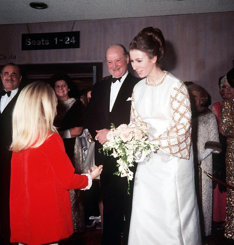 <p>Receiving a bouquet of flowers from Heather Ripley, one of the child stars of <em>Chitty Chitty Bang Bang</em>, at the film's premiere.</p>