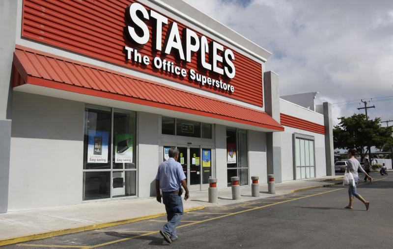 Staples 4Q hit by charges, forecast misses view