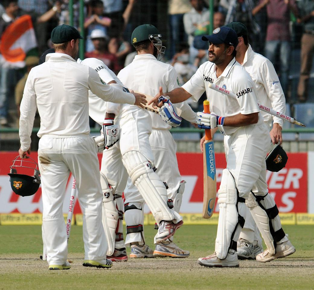 Indian Cricket Team and Australian Cricket Team shaking hand after the 4th test match of Border Gavaskar Trophy, at Ferozeshah Kotla Stadium in Delhi on March 24, 2013. P D Photo by P S Kanwar