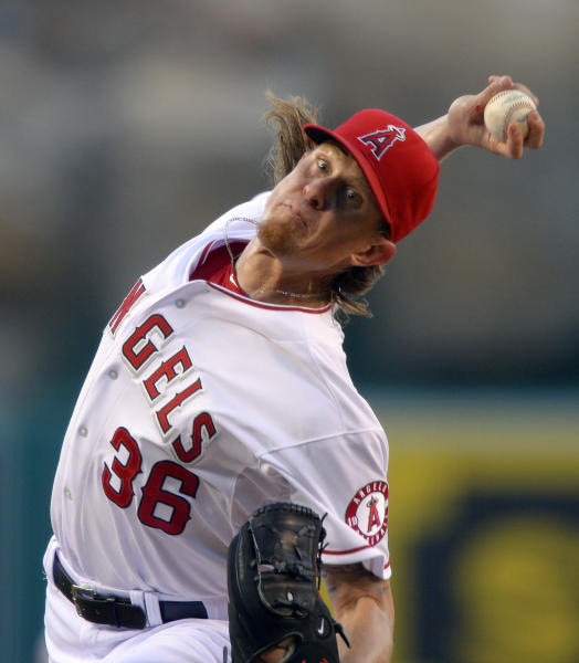 Los Angeles Angels starting pitcher Jered Weaver throws to the plate during the first inning of their baseball game against the Los Angeles Dodgers, Wednesday, May 29, 2013, in Anaheim, Calif. (AP Photo/Mark J. Terrill)