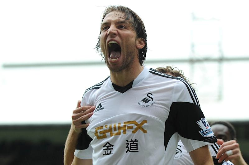 Swansea City's Spanish midfielder Miguel Michu celebrates scoring his team's first goal during the English Premier League football match between Crystal Palace and Swansea City at Selhurst Park in south London on September 22, 2013