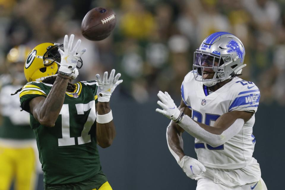 Green Bay Packers' Davante Adams catches a long pass in front of Detroit Lions' Ifeatu Melifonwu during the second half of an NFL football game Monday, Sept. 20, 2021, in Green Bay, Wis. (AP Photo/Matt Ludtke)