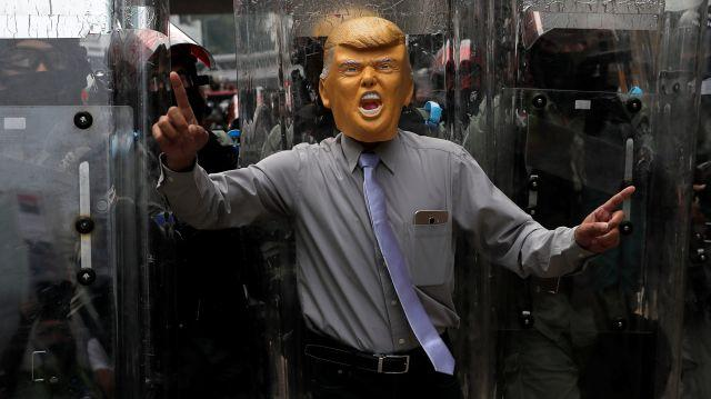 An anti-government protester wearing a mask depicting U.S. President Donald Trump demonstrates at Causeway Bay district in Hong Kong, China, September 29, 2019.