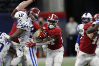 Alabama running back Jerome Ford (27) breaks through the line during the second half an NCAA college football game against Duke, Saturday, Aug. 31, 2019, in Atlanta. Alabama won 42-3. (AP Photo/John Bazemore)