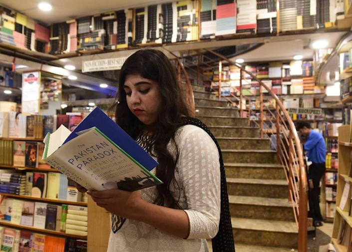 Luavut Zahid, one of the Pakistani founders of the Khabaristan Times website, poses at a bookstore in Islamabad (AFP Photo/Farooq Naeem)