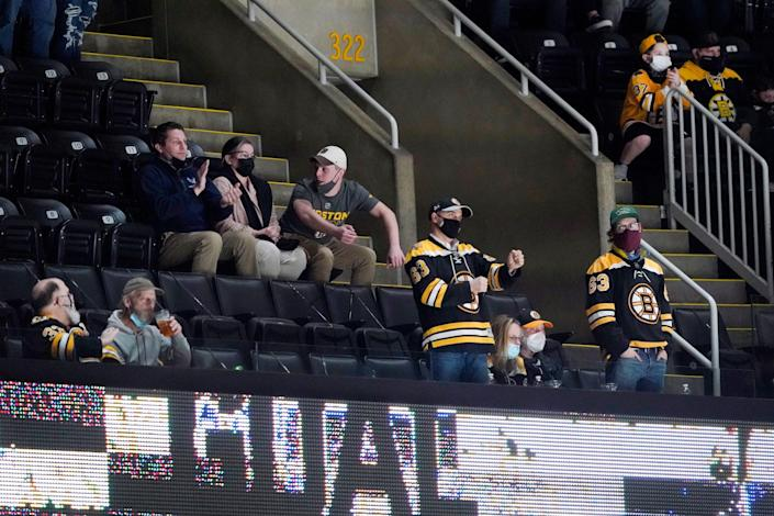 Fans cheer during the second period of an NHL hockey game between the Boston Bruins and the New York Islanders on May 10, 2021, at TD Garden in Boston.