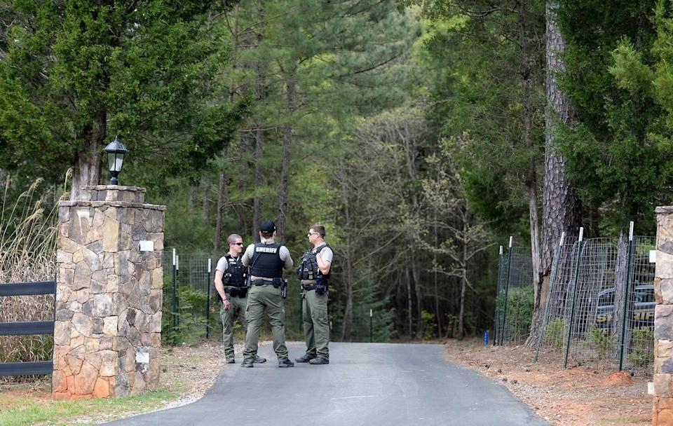 York County Sheriff deputies guard an entrance to the residence of Dr. Robert Lesslie on Thursday, April 8, 2021. Former NFL player Phillip Adams shot 6 people on Wednesday, April 7, 2021 killing Dr. Robert Lesslie, his wife, two grand children and a Gaston HVAC worker. Robert Shook, another Gaston HVAC worker was severely wounded during the shooting in York County. Adams later killed himself at his parents home.
