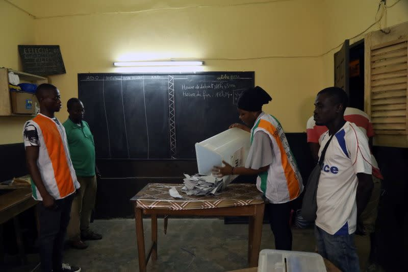 Election officials start to count the ballots during the presidential election in Abidjan