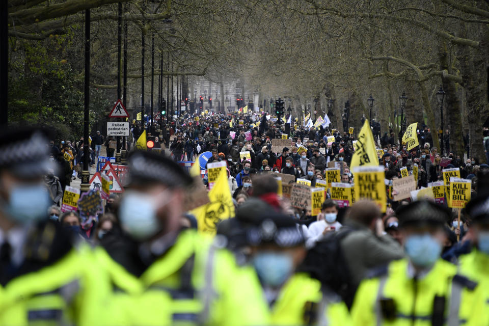 Demonstrators hold banners and flags during a 'Kill the Bill' protest in London, Saturday, April 3, 2021. The demonstration is against the contentious Police, Crime, Sentencing and Courts Bill, which is currently going through Parliament and would give police stronger powers to restrict protests. (AP Photo/Alberto Pezzali)