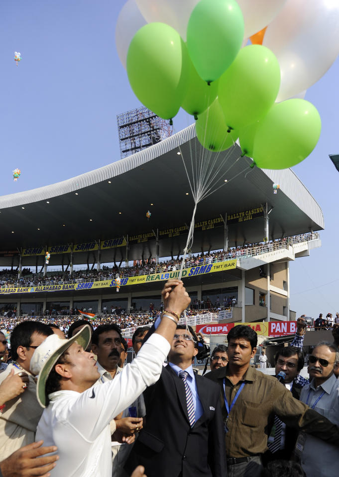 Sachin Tendulkar of India along with Sourav Ganguly of India releases baloon in the air to celebrate the 199th test of the prior during day three of the first Star Sports test match between India and The West Indies held at The Eden Gardens Stadium in Kolkata, India on the 8th November 2013  Photo by: Pal Pillai - BCCI - SPORTZPICS