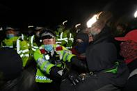 Officers scuffled with some members of the hundreds-strong crowd that gathered despite coronavirus restrictions